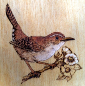 Realistic woodburned wren takes more time to create.